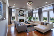 Bella Glass Bubbles Chandelier installed in a living room setting centered over coffee table in a seating area
