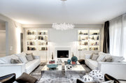 Loren Clear Rope Glass Chandelier shown installed in a living room setting over a large coffee table