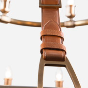 Close up view of leather strap detail of the Redford Leather Round Chandelier