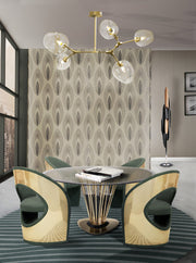 Rhome Mid-Century Chandelier in Painted Brass shown installed over round dining table