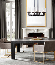 Talin Round Chandelier in acid metal black shown installed over a dining room table
