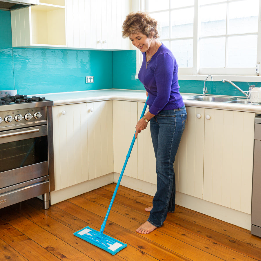 Woman in a kitchen using a Sweep and Swipe Mop
