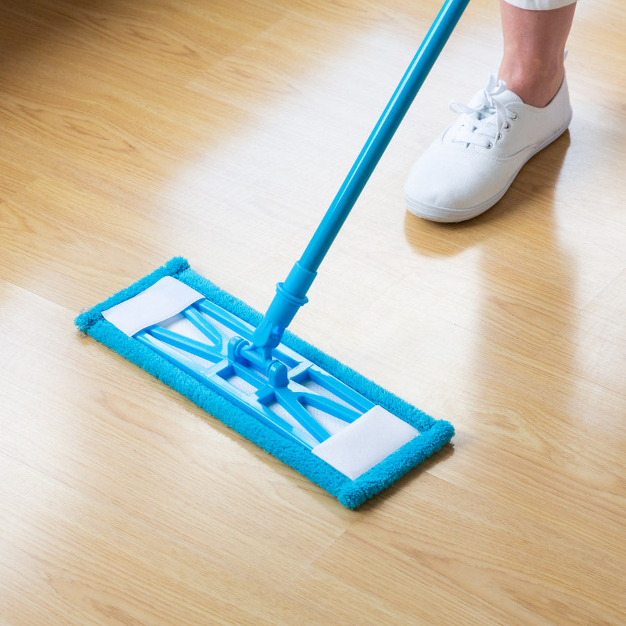 Zoomed in view of a person using the Kleva Sweep and Swipe Flat mop