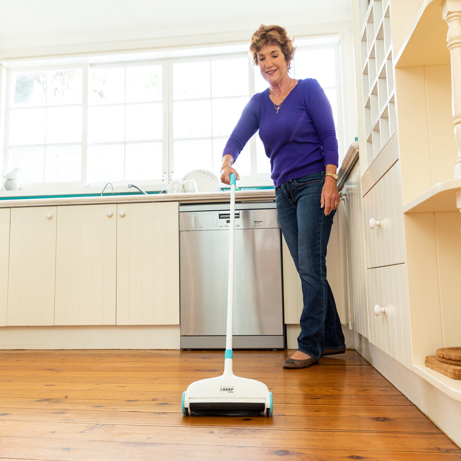 Woman using the Sweep and Keep in a kitchen
