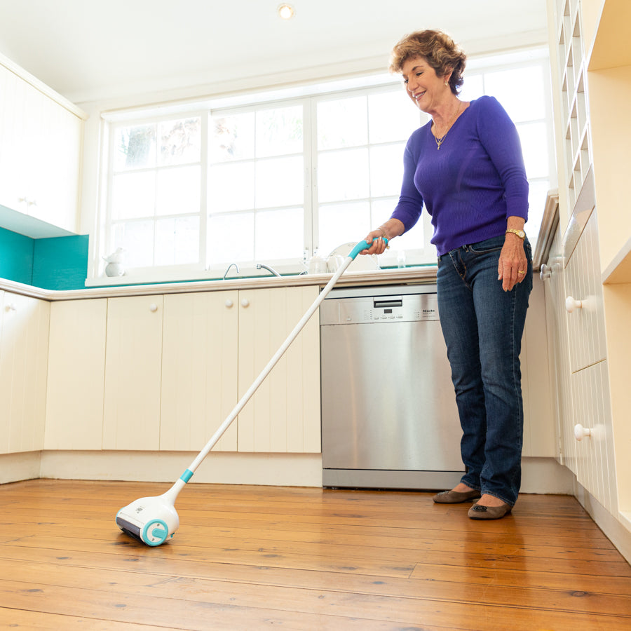 Woman in a kitchen using the Sweep and Keep