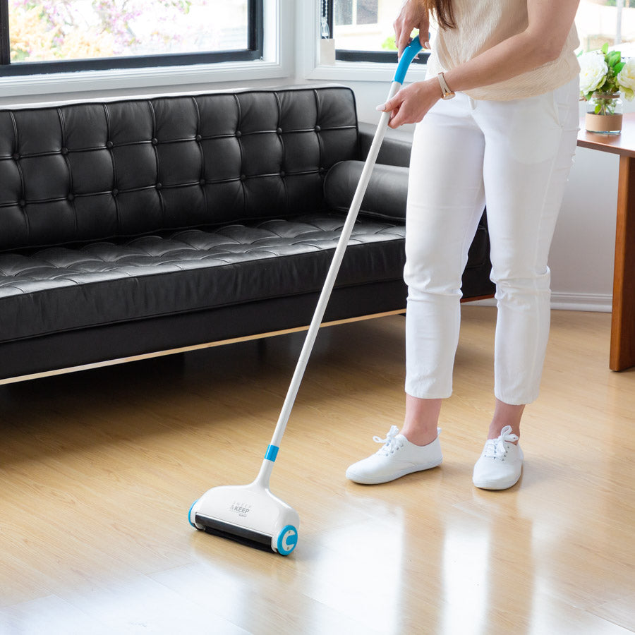 Person in a living room using a Sweep and Keep