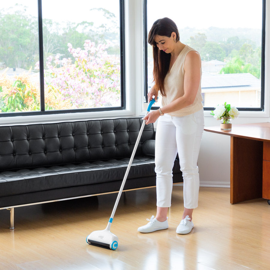 Woman in a living room using a Sweep and Keep