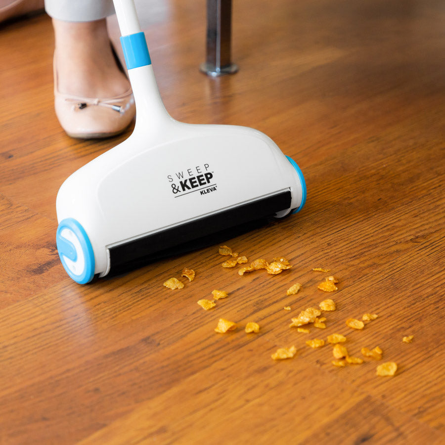 Sweep and Keep being used on a wood floor to clean up cereal