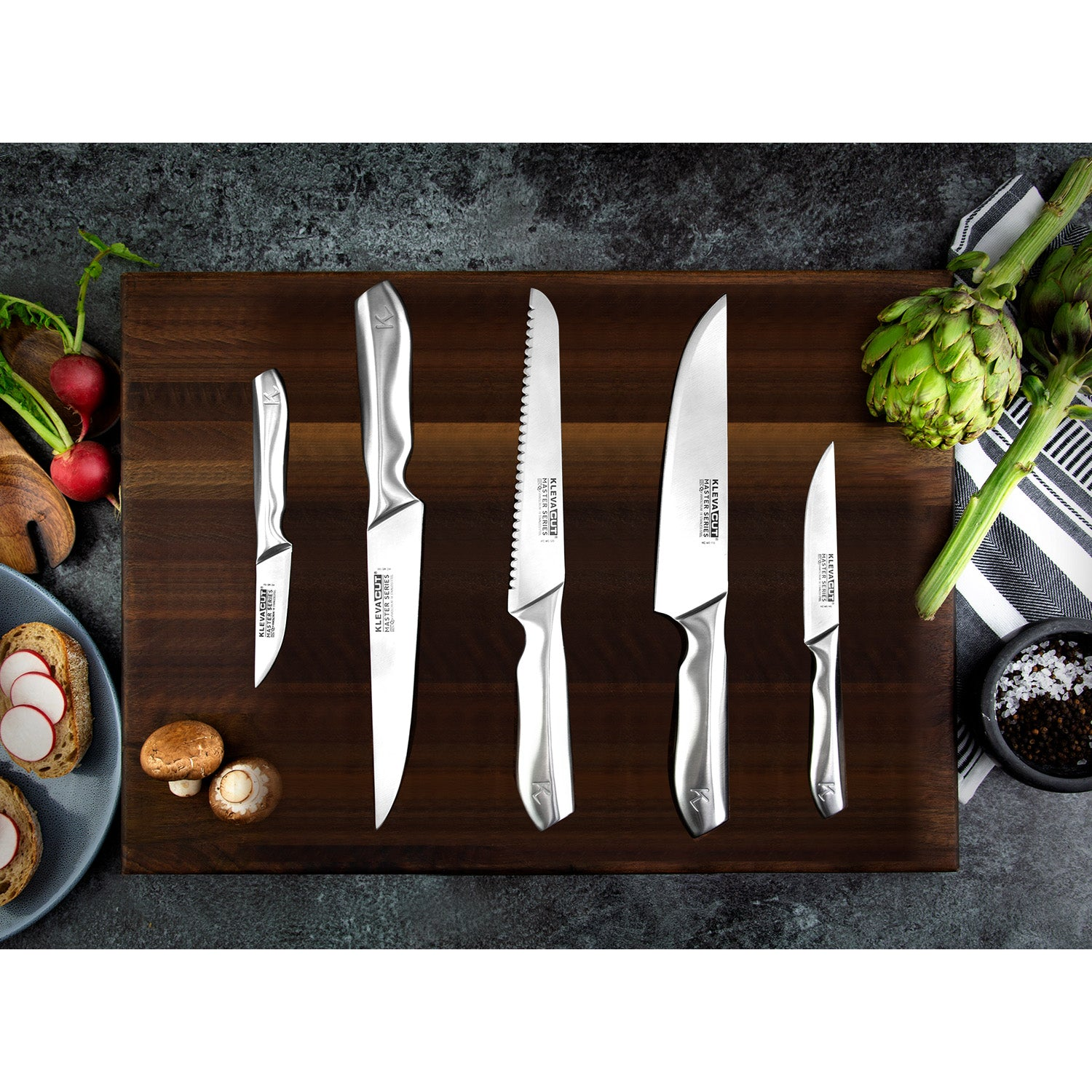 5 Piece Professional KlevaCut® Master Series on a cutting board