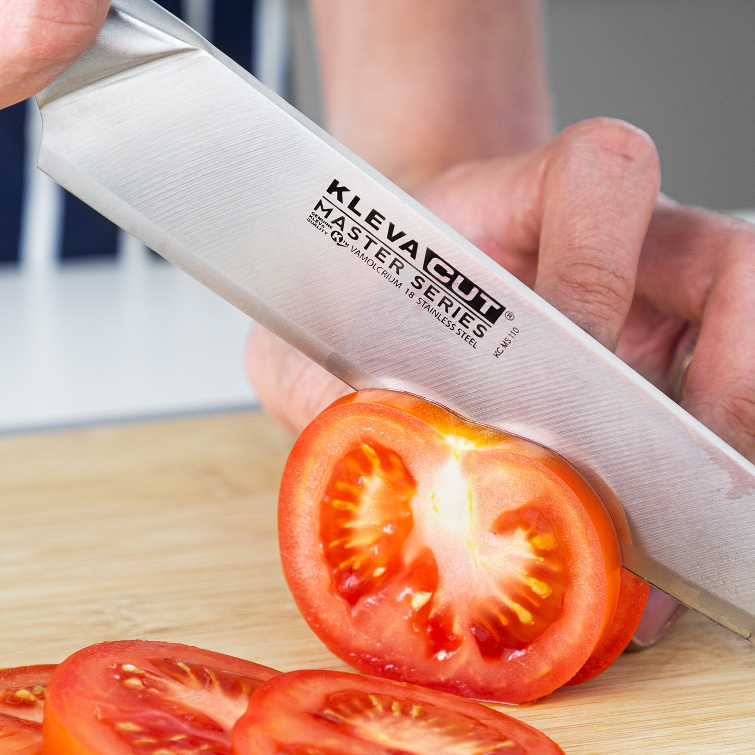 Kleva Cut Master Series Chef Knife slicing a tomato