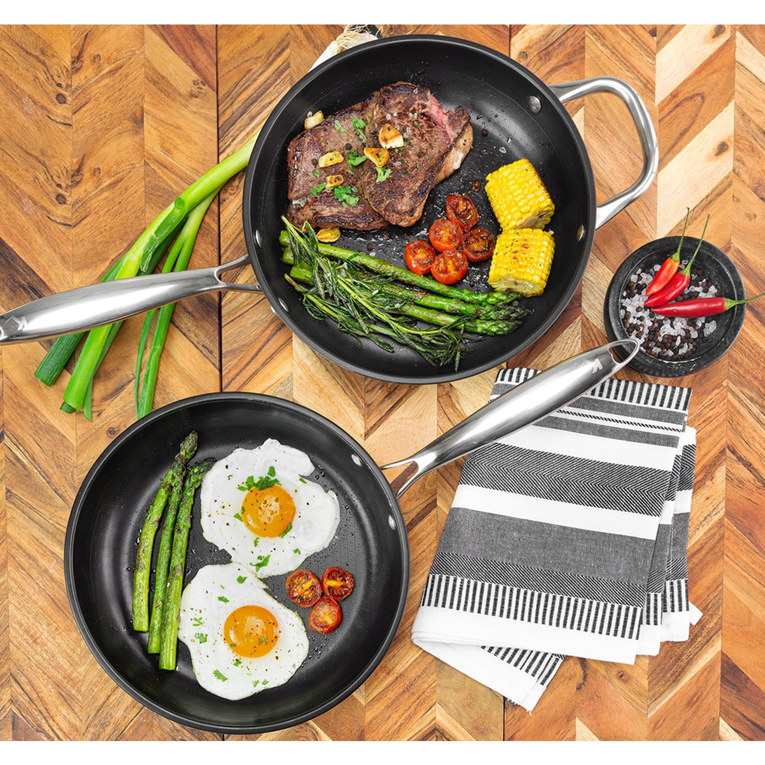 Two Perfect Pro Pans with cooked food on a table