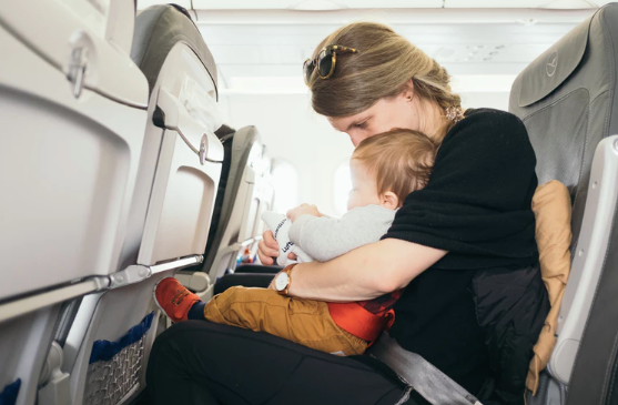 Mother and baby on a flight