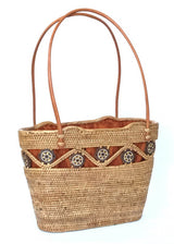 The Laura tote is handwoven Bali basket purse lined in solid brown fabric right angle.