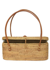 The Samar handwoven Bali basket purse with carved turtle front and open lid.