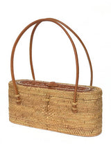 The Samar handwoven Bali basket purse with carved turtle left angle.