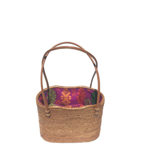 The Lulu handwoven Bali basket pink batik lined purse top view.