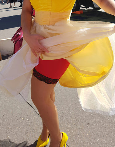 Red anti-chafe shorts by Miss Monroes shown under yellow dance dress