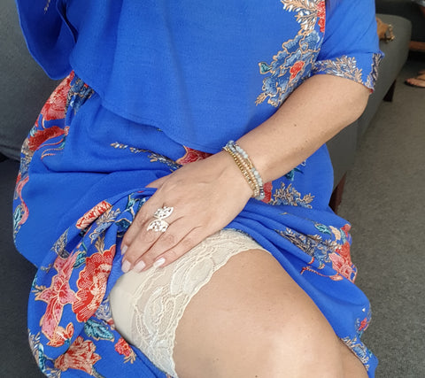 Nude/beige lace anti chafe shorts by Miss Monroes.com under a Blue floral dress