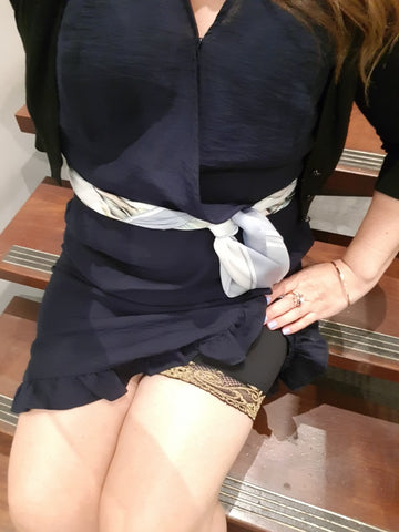 Customer wearing Miss Monroes black and gold anti-chafe shorts under black  dress