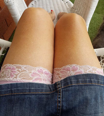 Pink anti-chafe shorts under blue denim skirt