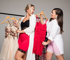 Women selecting dresses from a rack