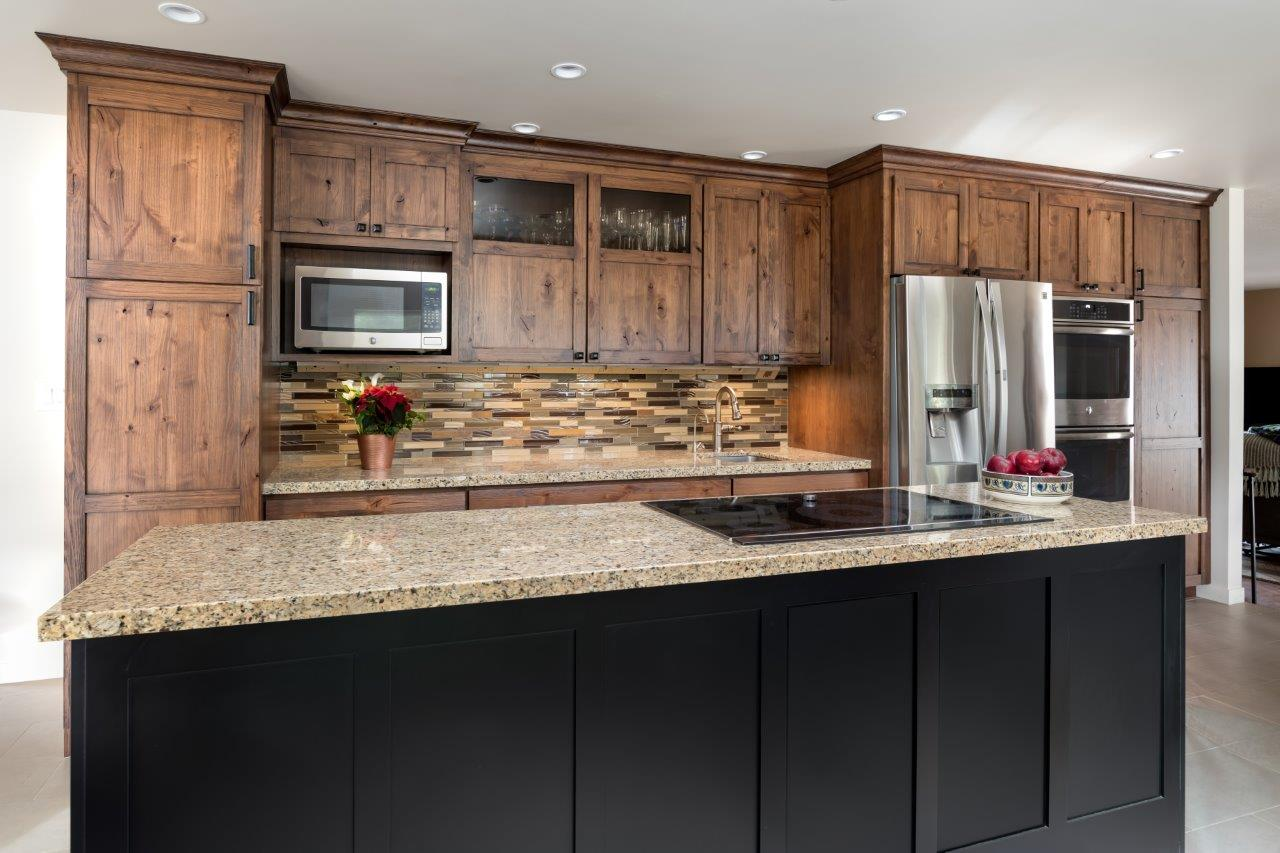 Kitchen Prep Area Island Cooktop, Knotty Alder & Black Painted Cabinets by Jackie Lopey Venue