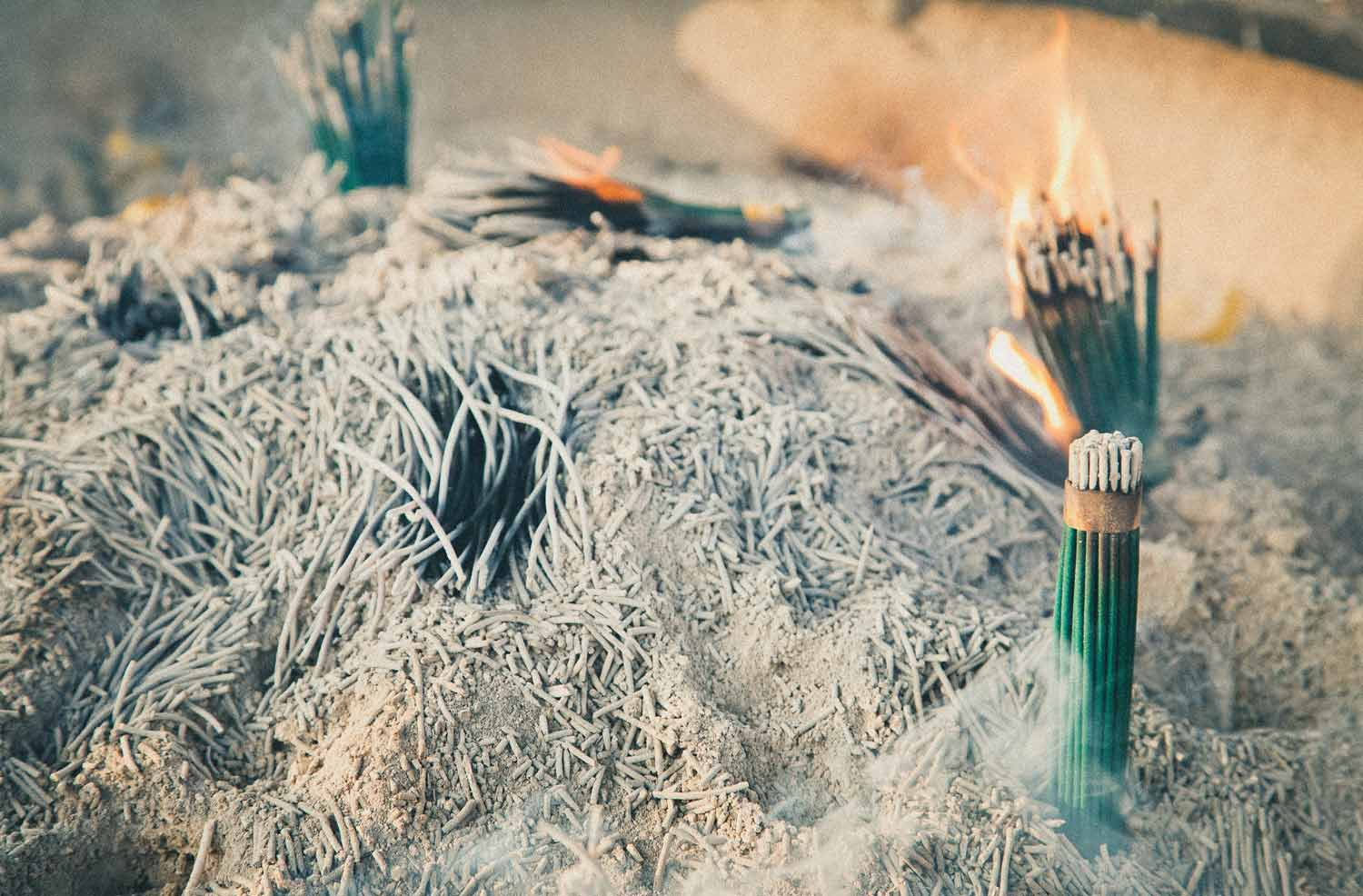 so we flow... Incense burning in a pile of ashes