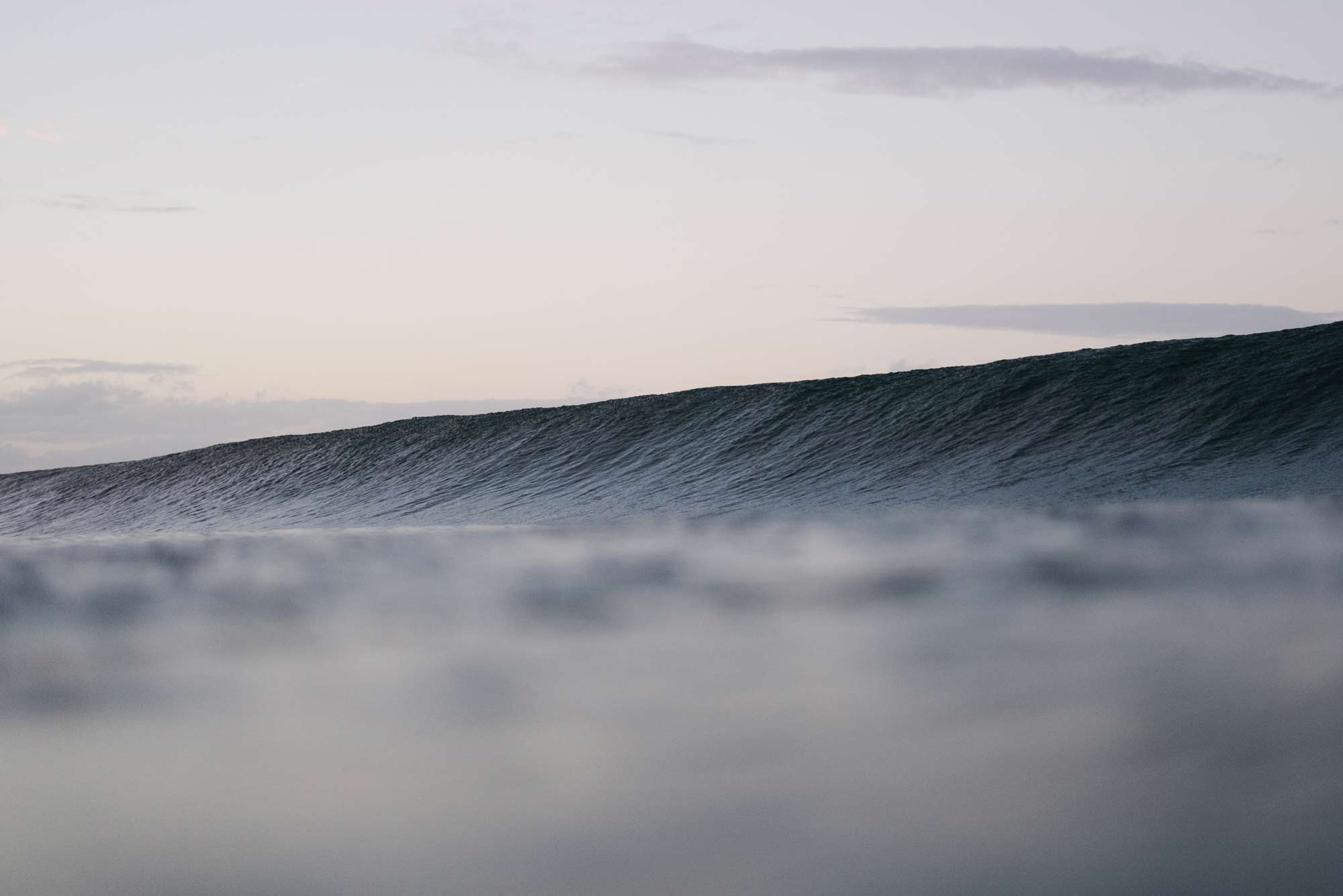 Photo of a wave during dusk