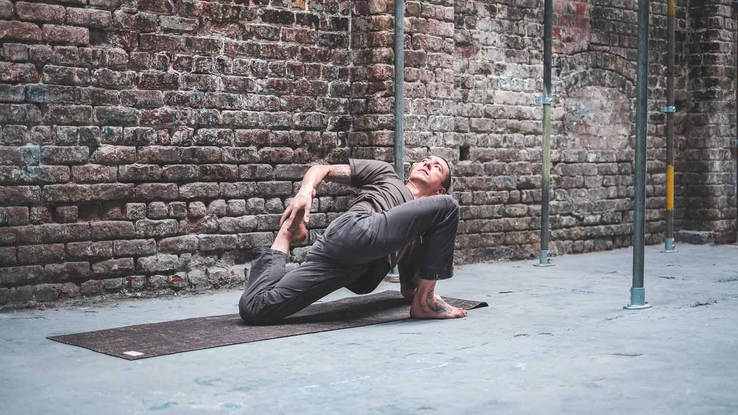 Sam Fong Brooks doing a bound lunge wearing So We Flow...