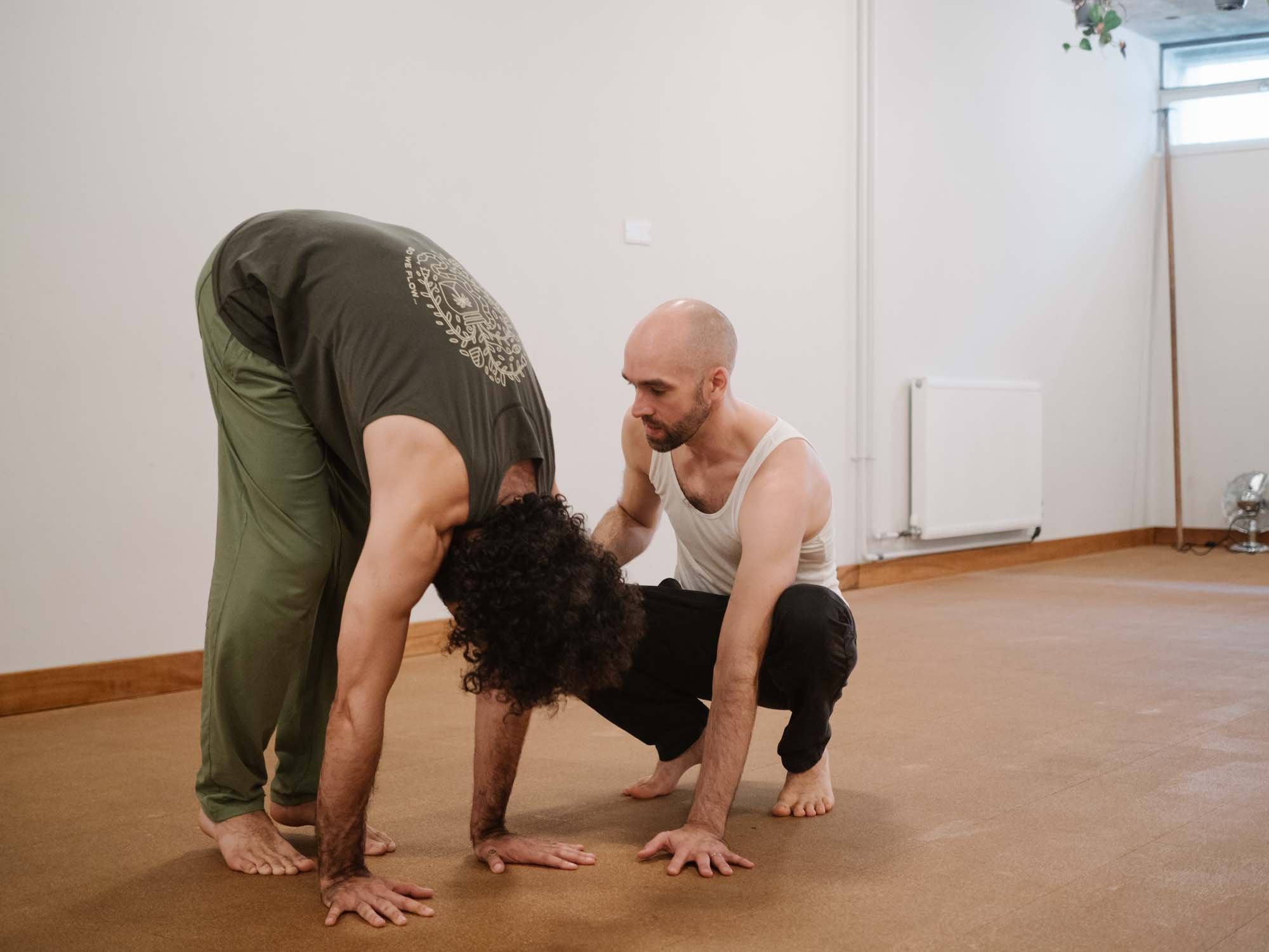 Matt Gill teaching Richard Melkonian how to handstand