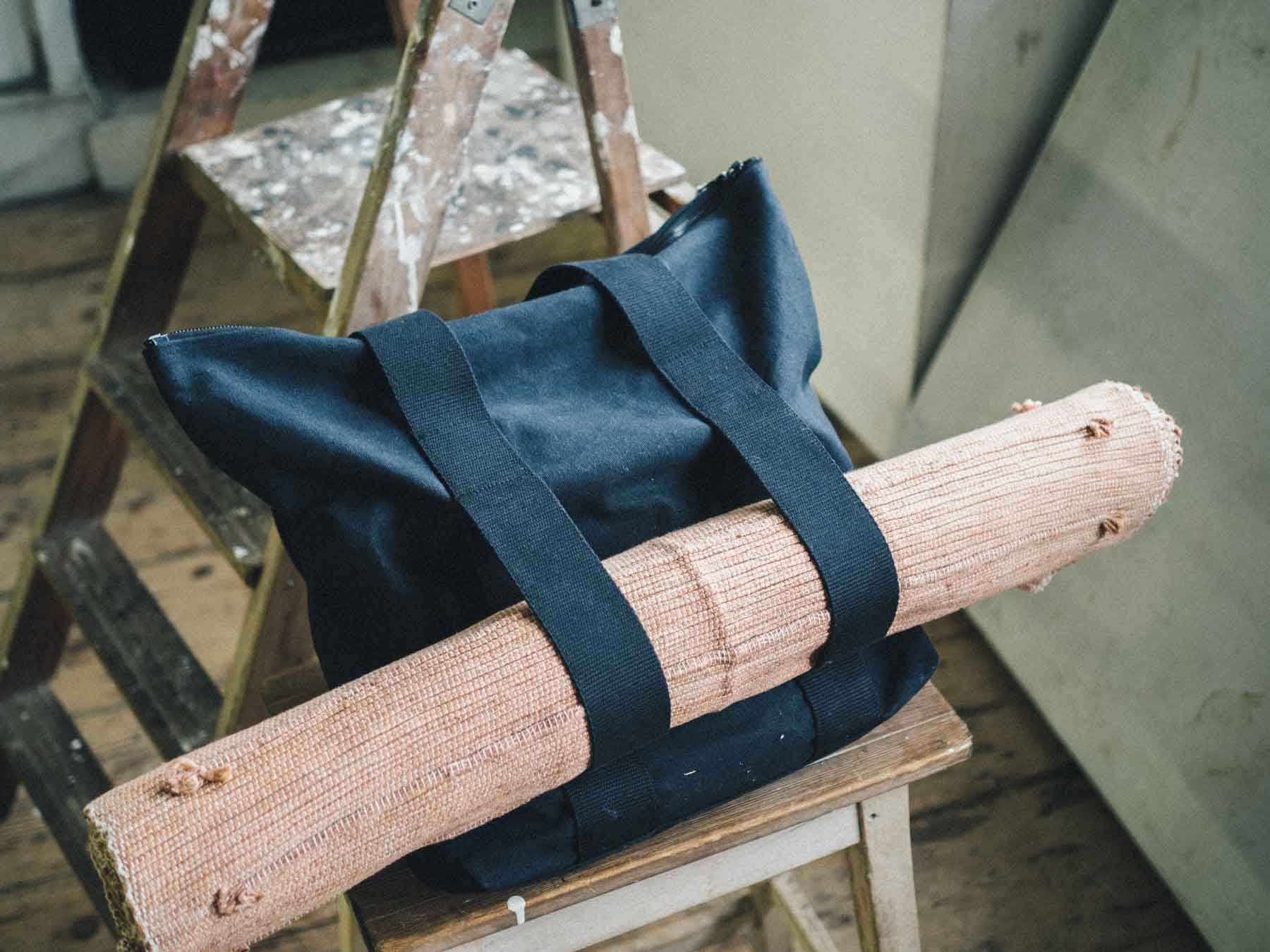 so we flow... Yoga Tote Bag holding an Honest Yoga Mat in Terracotta