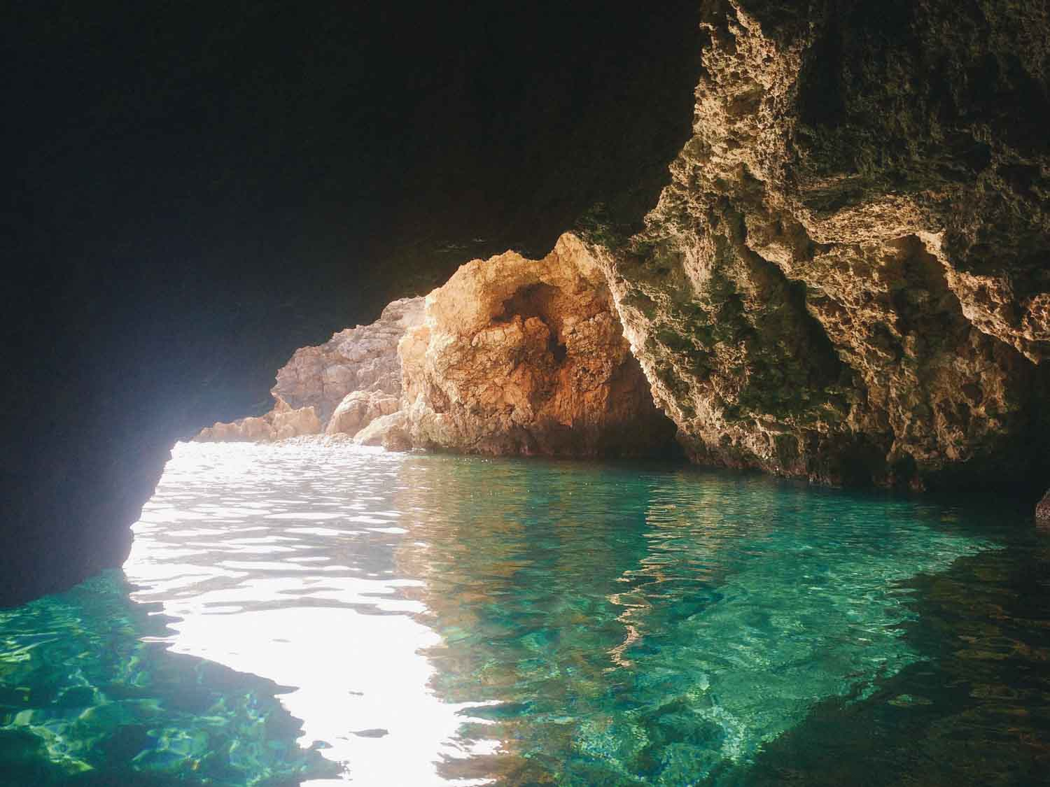 Cave in Ibiza with turquoise, clear water