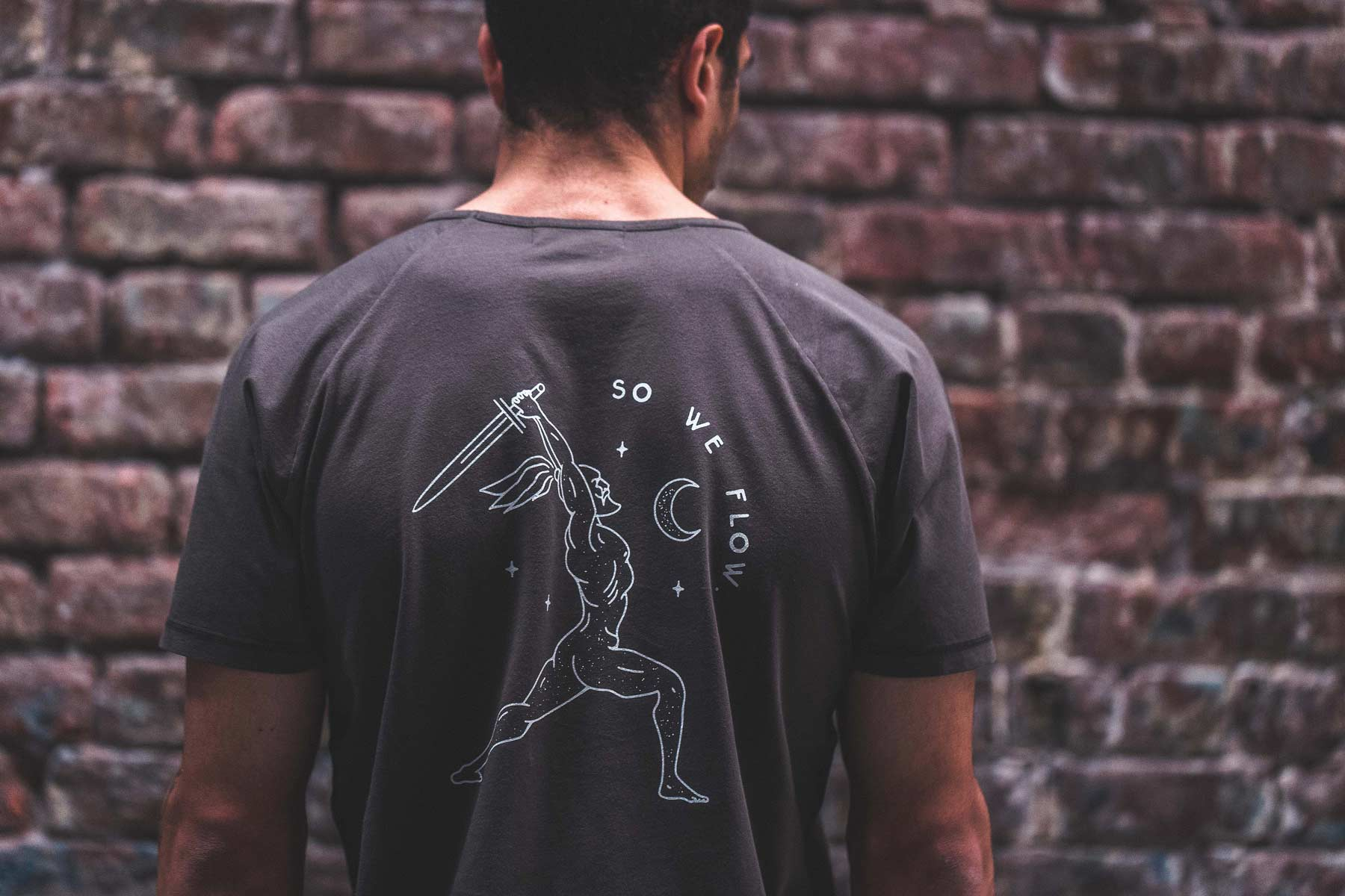 Man wearing so we flow... Warrior yoga T-shirt