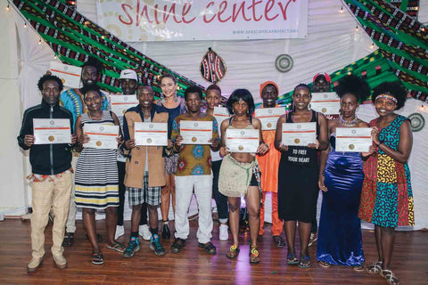 Group of African yoga teachers with their certificates