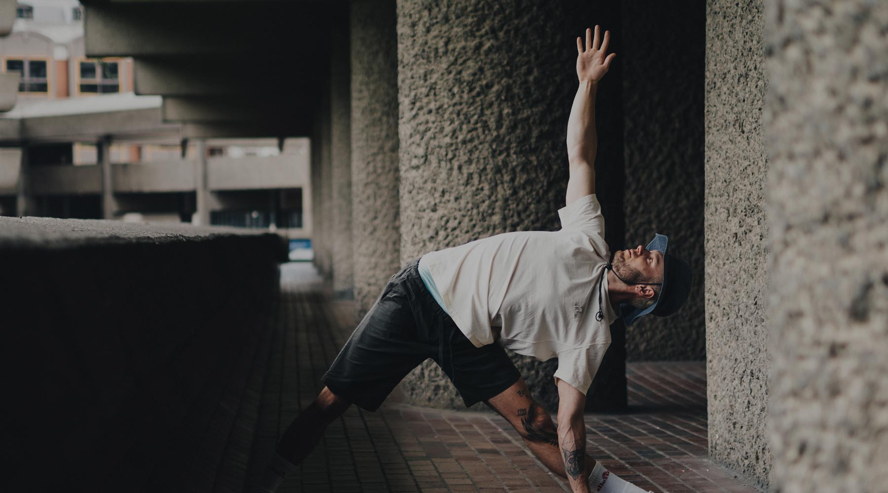 Man doing Triangle Yoga Pose wearing So We Flow...