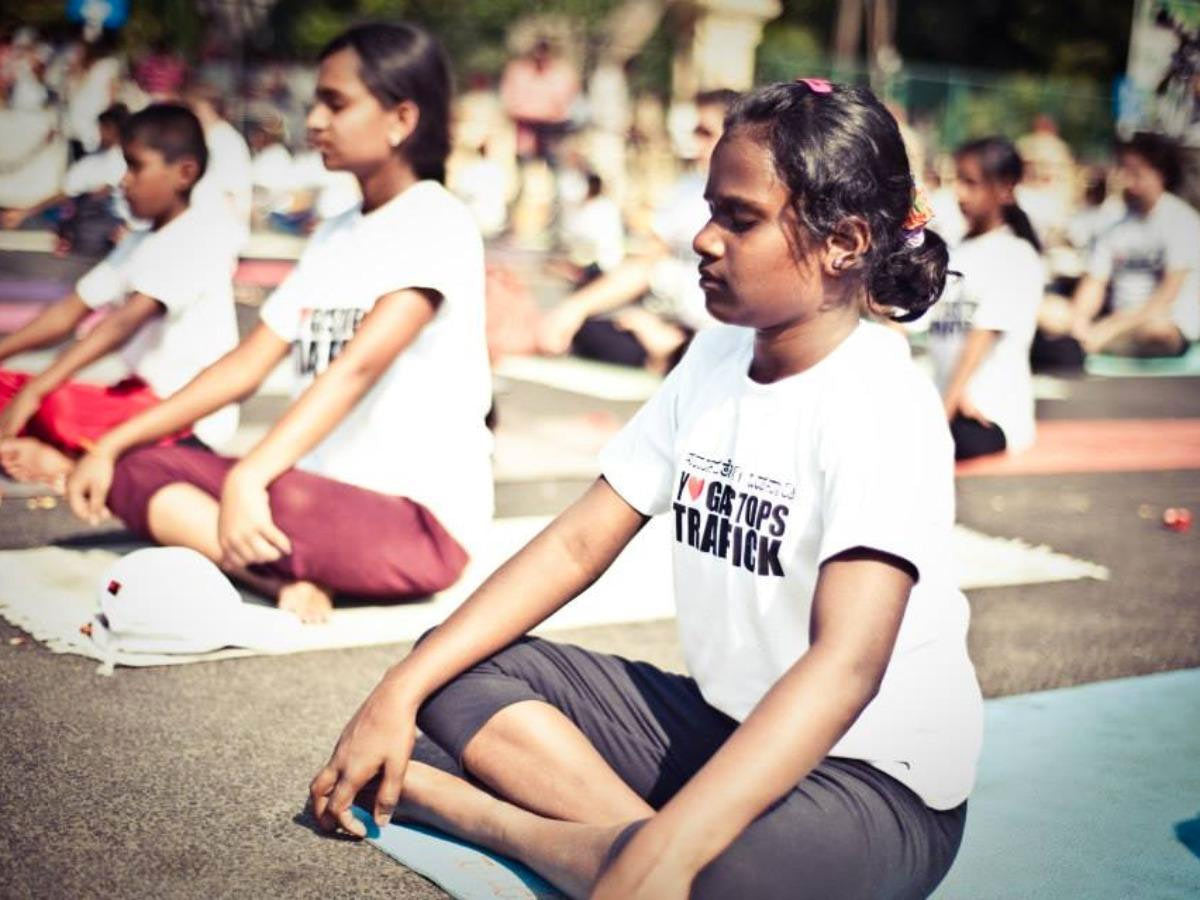 Yoga Stops Traffick girl meditating