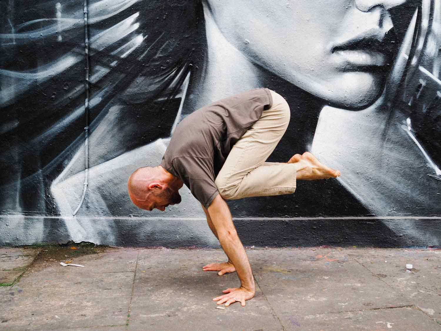 Matt Gill in crow pose on a street in London