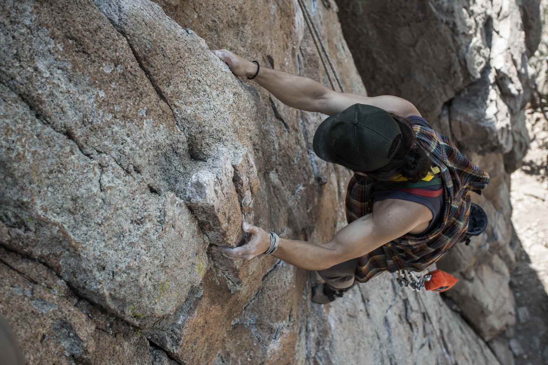 Man climbing rock face