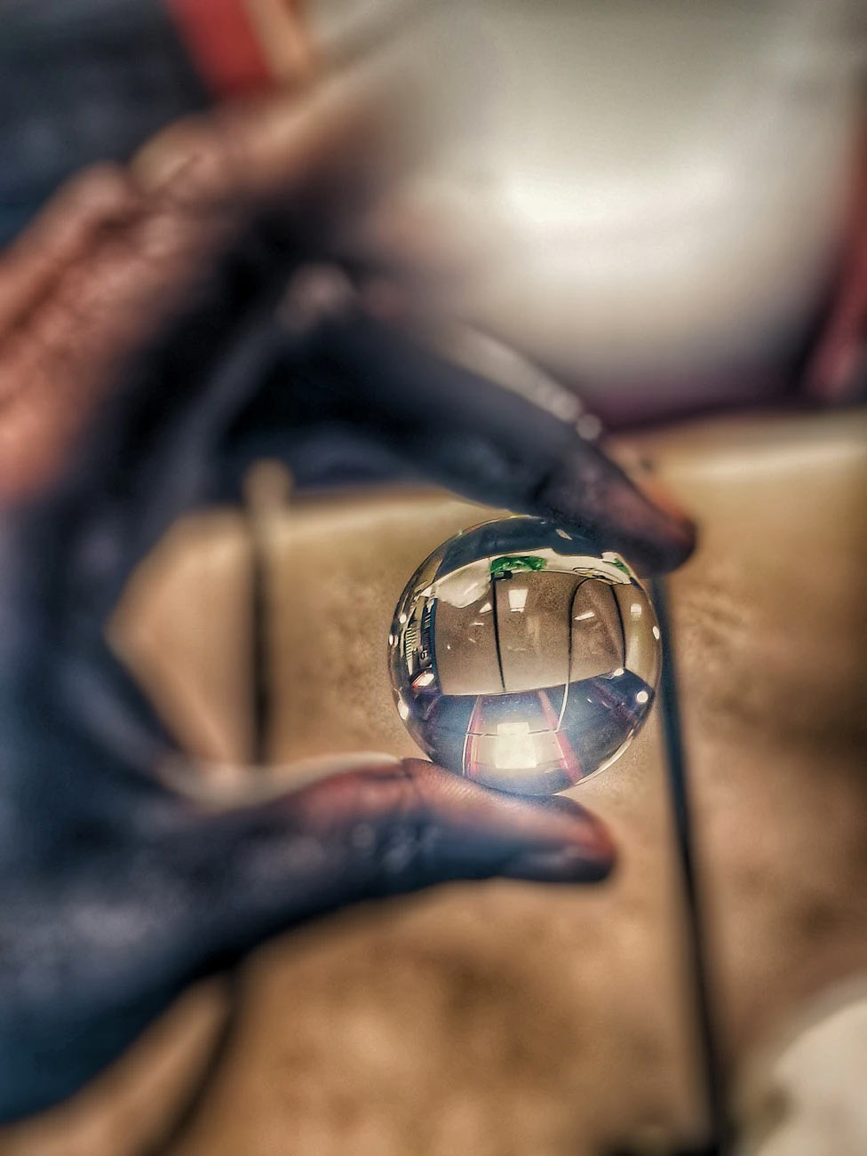 Man holding glass ball