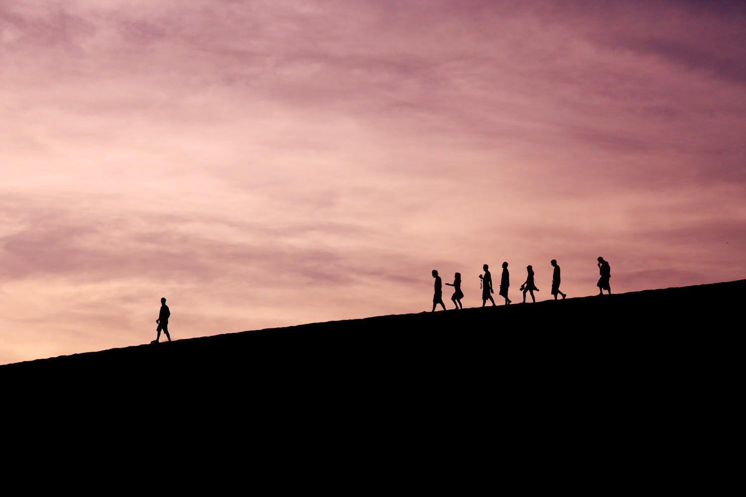 A man leading people silhouette