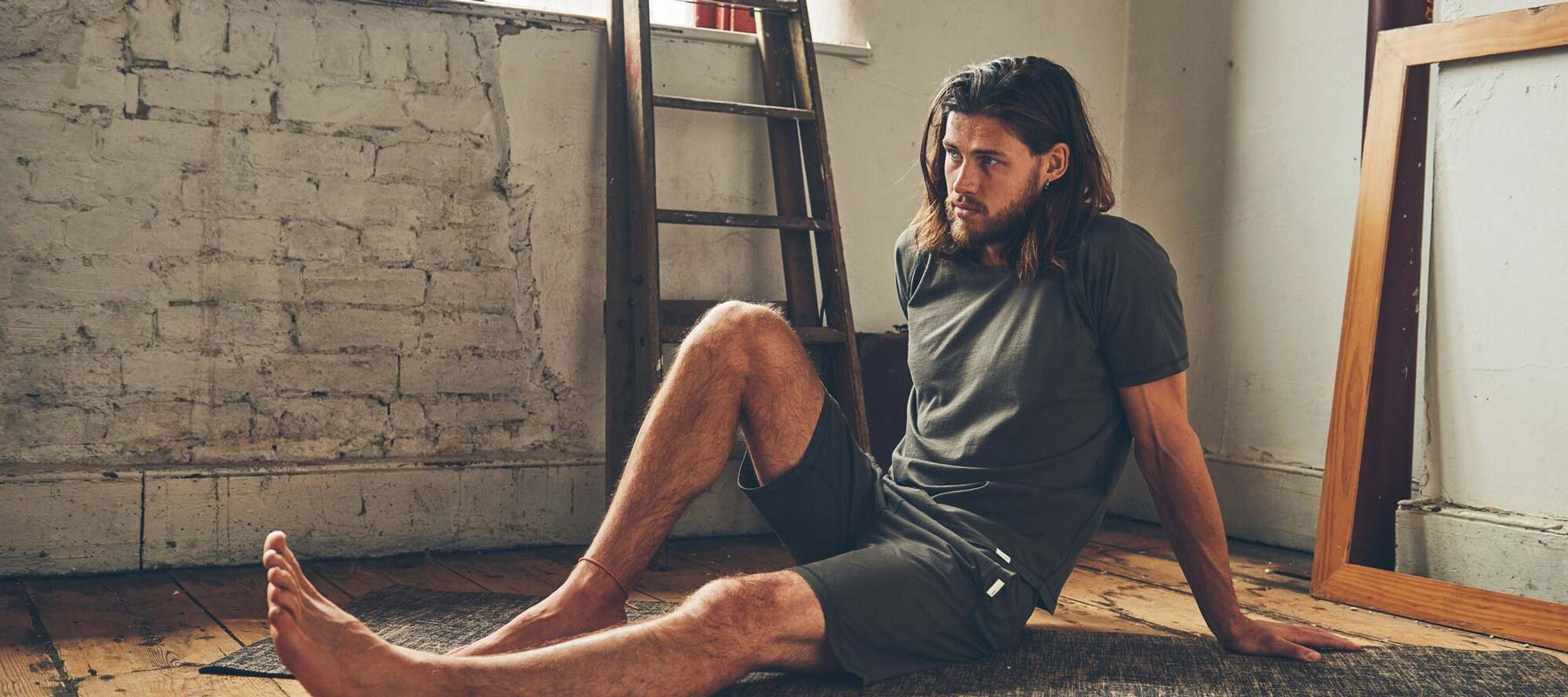 Man wearing So We Flow Men's Yoga Starter Kit