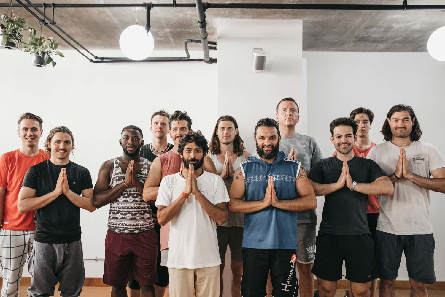 Group of men standing together after a yoga class