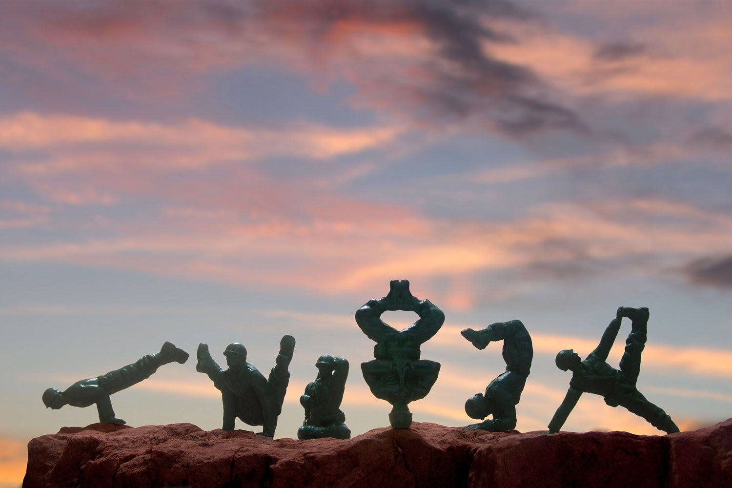 Yoga Joes army men doing yoga in the desert