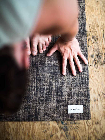 Man practicing yoga on the so we flow... mens jute natural yoga mat