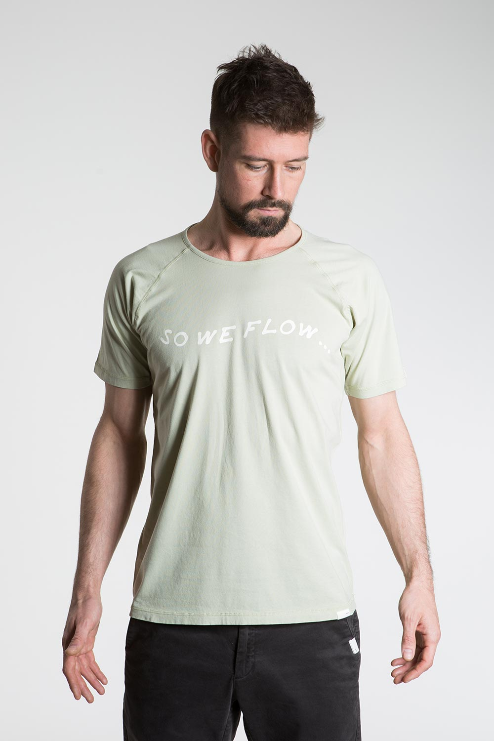 so we flow... mens green yoga t-shirt with logo graphic front view