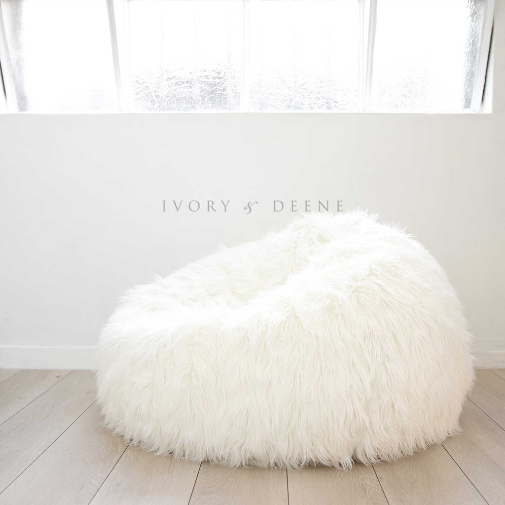 Superieur White Lush Fur Beanbag On A Wooden Floor Underneath A Warehouse Window