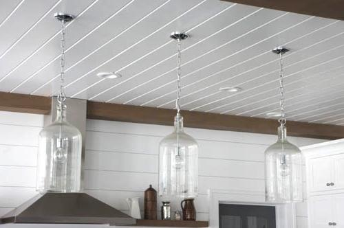 Glass jug pendant light kendal ivory deene three glass jug pendants hanging from wooden ceiling in kitchen with vintage edison globe aloadofball Images