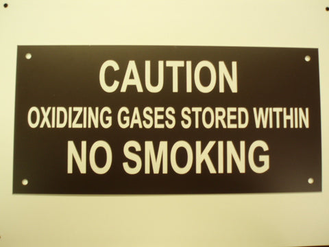 CAUTION OXIDIZING GASES STORED  WITHIN NO SMOKING