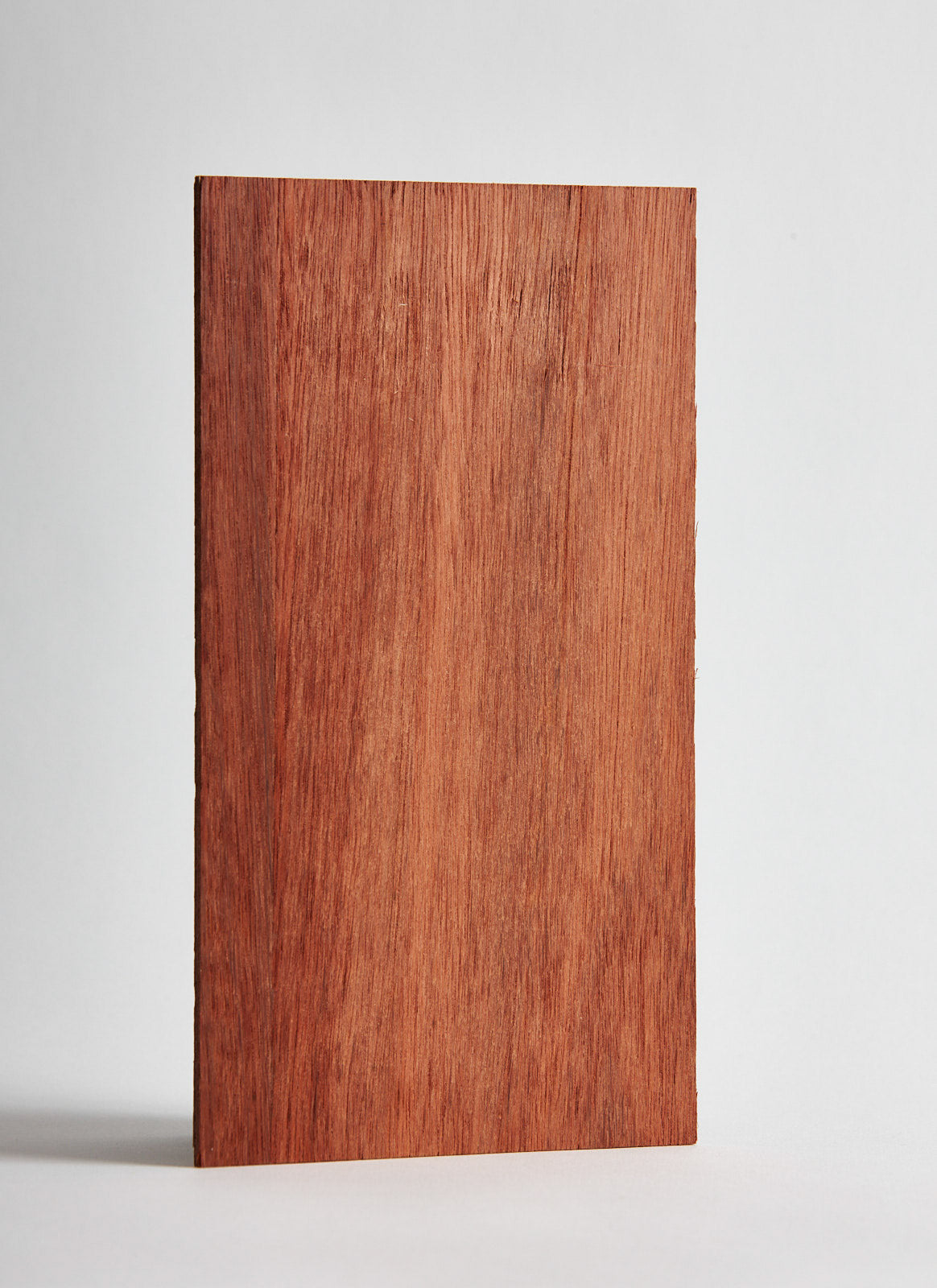 --Plyco's Jarrah 3mm Laserply on a white background--