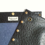 Black textured leather button cube bag - blue denim